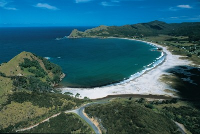 Aerial photo of the length of Medlands Beach and Oruawharo Bay, Great Barrier Island.